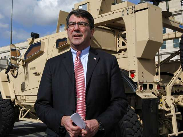 Deputy Defense Secretary Ashton Carter standing in front of a MRAP all terrain vehicle (M-ATV) at the Pentagon in Washington.