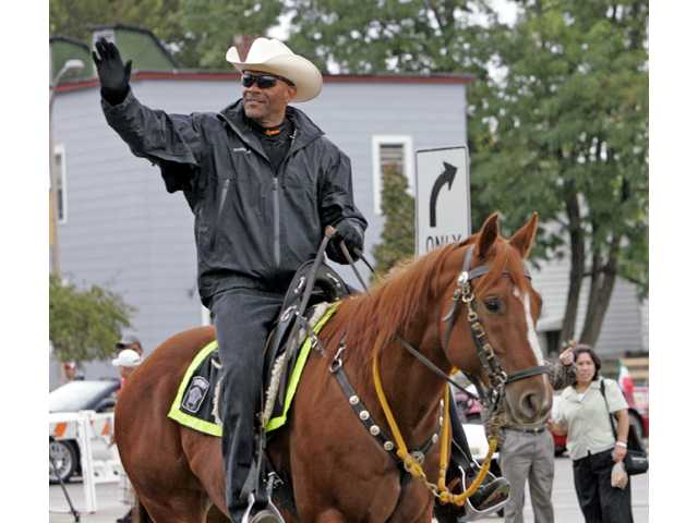 Milwaukee County Sheriff David Clarke Jr. rides his horse during the Mexican Independence Day Parade in Milwaukee, Wis.