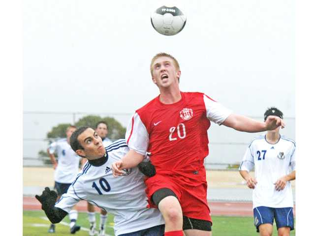 Hart's Riley Waldeck (20) vies for a header over a West Ranch defender on Friday at West Ranch High.