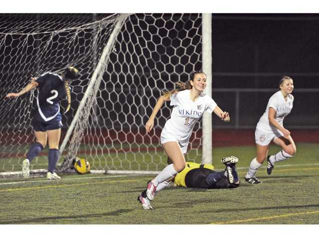 Valencia's Natalie Hein (17) and Samantha Simon (6) celebrate after the Vikings' fourth goal against Saugus on Friday.