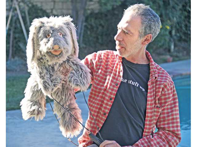 "Trautman, right, and ""Mr. Floppy"" the puppet he manipulated on the '90s TV show ""Unhappily Ever After."""
