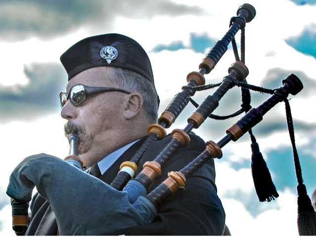 "Bagpiper and lifelong Canyon Country resident Chris Carson plays ""Going Home"" on his bagpipes graveside for a funeral at Oakwood Memorial park in Chatsworth on Saturday."