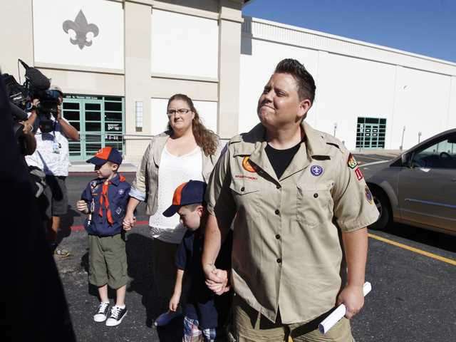 In this July 18, 2012 file photo, Jennifer Tyrrell, right, arrives for a meeting at the Boys Scouts of America national offices in Irving, Texas, with her son Jude Burns, 5, second from right, partner Alicia Burns, and son Cruz Burns, 7, left. (AP)