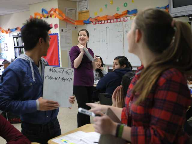 Teacher Crystal Kirch, center, talks to her students in her pre-calculus class at Segerstrom High School in Santa Ana, on Wednesday. (AP)