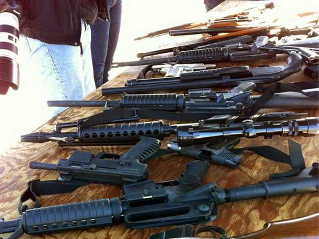 This image provided by the San Mateo County Sheriff's Department shows some of the guns offered during a buyback program Saturday in San Mateo. (AP)