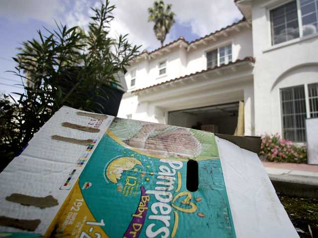 In a March 22, 2011 file photo, a diaper box sits in front of a group of town homes on Palm Avenue in San Gabriel, Calif. that were illegally modified into a maternity ward, according to authorities. (AP)