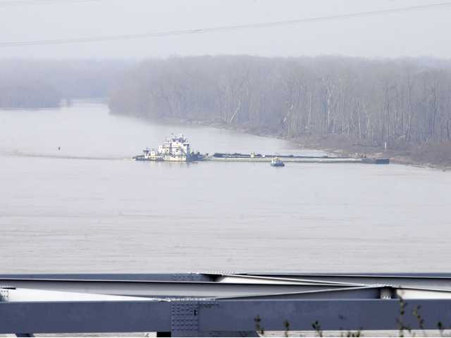 The towboat Nature Way Endeavor banks a barge against the western bank of the Mississippi River, on Sunday. (AP)