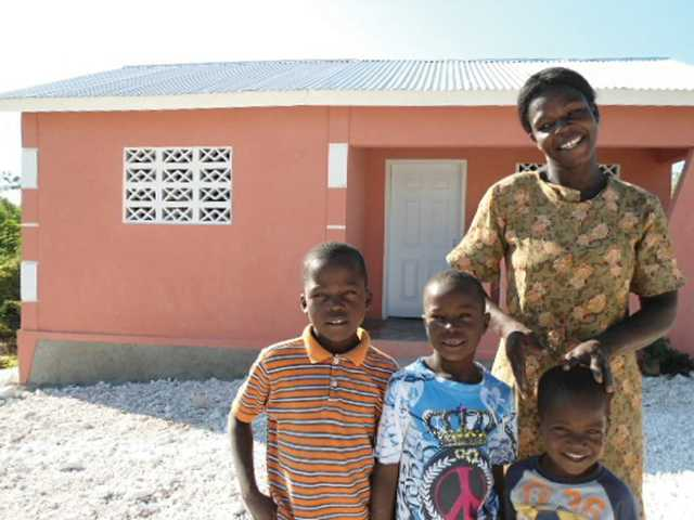 The Sanon family, in Mouillage Fouquet, Haiti stand in front of their new home built from funds raised by students in Greg Hayes' Valencia High School government class. Students raised $3,732 from a variety of fundraising efforts. (Courtesy Food for the Poor)