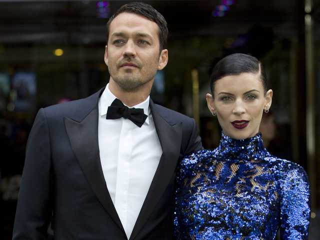 "In this May 14, 2012 file photo, actress Liberty Ross with director Rupert Sanders pose for the media at the World Premiere of the film, ""Snow White and the Huntsman,"" at a cinema in central London."