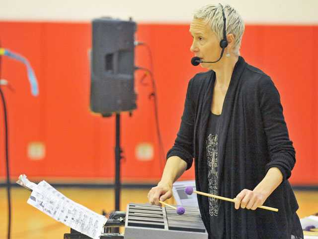 Amy Knoles demonstrates electronic music produced with a percussion controller for students at Arroyo Seco Junior High School in Saugus on Monday. The assembly was part of a day of enrichment for Arroyo Seco students. (Jonathan Pobre/The Signal)