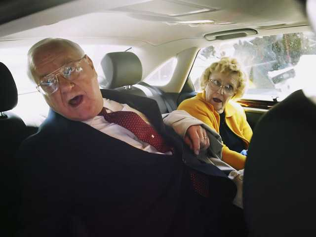 In this April 17, 2006 file photo, former Illinois Gov. George Ryan sits in a car with his wife, Lura Lynn.