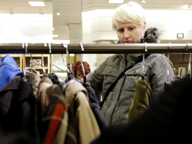 A woman shops at a Nordstrom store in Chicago Jan. 20. U.S. consumer confidence plunged in January to its lowest level in more than a year.
