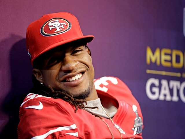 San Francisco 49ers safety Dashon Goldson (38) smiles during media day for the NFL Super Bowl XLVII football game in New Orleans.