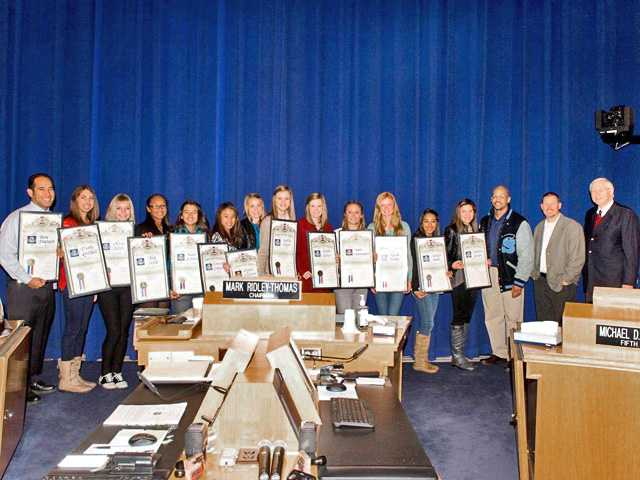 Members of the Saugus High School girls cross country team stand with coaches and Supervisor Michael D. Antonovich at a meeting of the Los Angeles County Board of Supervisors on Tuesday.