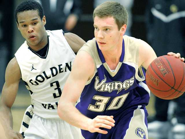Valencia's Garrett Mike (30) drives against Golden Valley defender James Chevious (3) at Golden Valley on Tuesday.