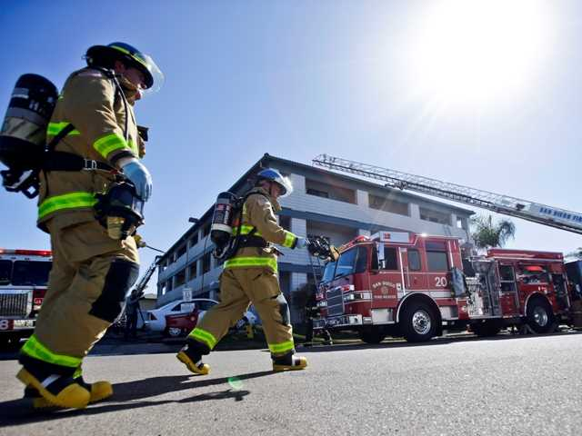 Firefighters respond to an explosion at a San Diego hotel near SeaWorld on Wednesday. Three people were injured in the explosion.
