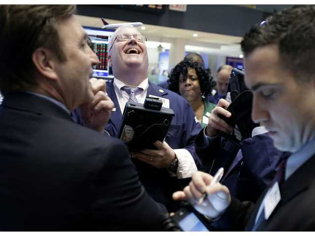 A trader laughs while working on the floor of the New York Stock Exchange in New York, Thursday.