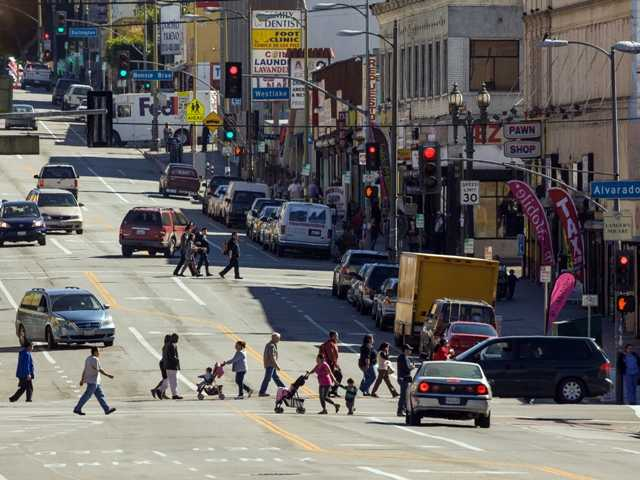 People gather at South Alvarado Street and West 7th Street, on Thursday, an area with high density of Latin American descent immigrants resides in Los Angeles.