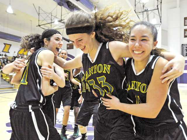 From left, Canyon High's Monica Friedl, Delaney McCann and Marissa Schwimmer celebrate their 52-45 comeback win over Valencia High on Friday night at Valencia.