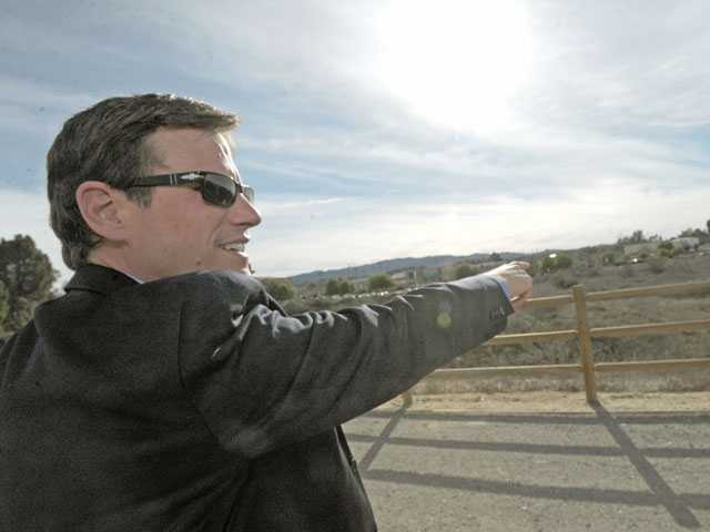 Dow points west from the Iron Horse Trailhead to describe possibilities for installations. (Jonathan Pobre/The Signal)
