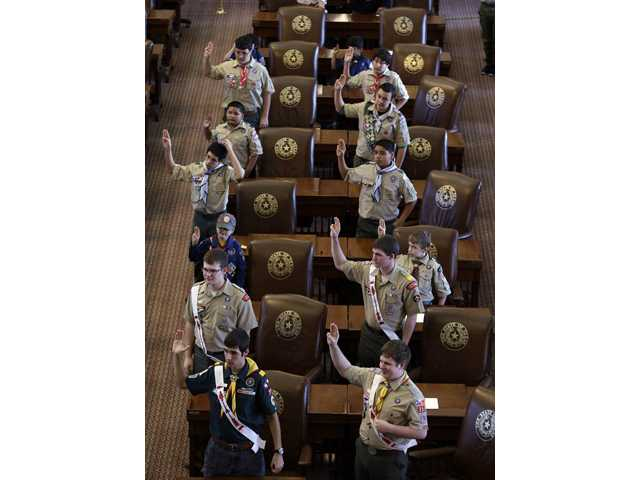 Boy Scouts recite the Scout Oath during the annual Boy Scouts Parade and Report to State.