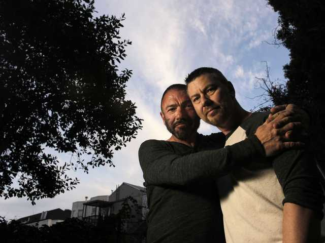 In this Jan. 4, 2012 file photo, Bradford Wells, left, and Anthony John Makk pose together at their home in San Francisco.