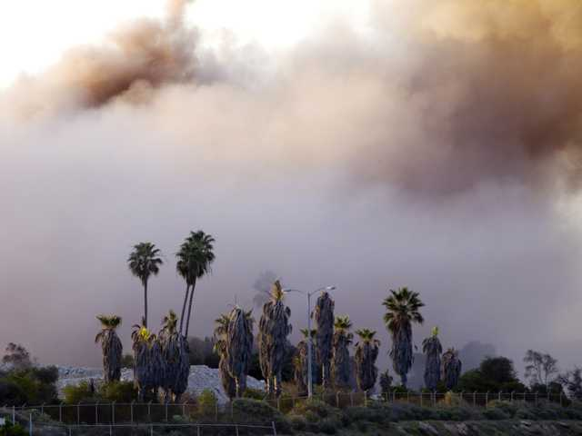 A cloud of smoke is all that remains of the South Bay Power Plant, Saturday, in Chula Vista, Calif.