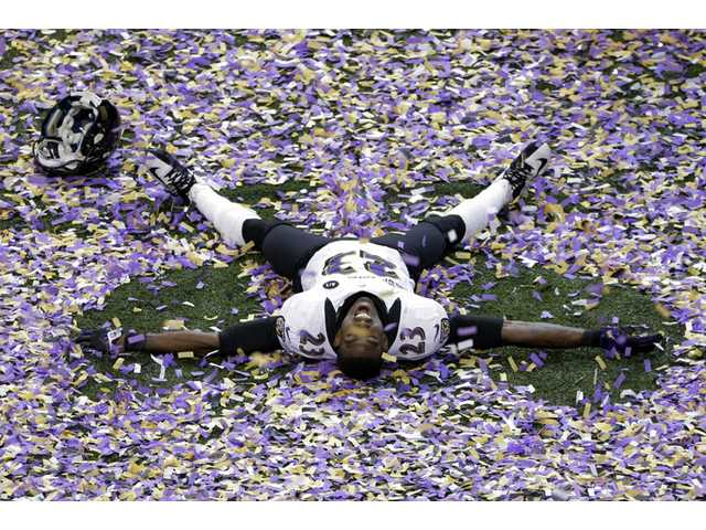 Baltimore Ravens defensive back Chykie Brown (23) celebrates after Super Bowl XLVII