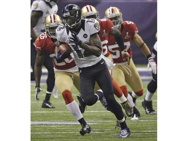 Baltimore Ravens' Jacoby Jones (12) returns a kickoff for a 109-yard touchdown against the San Francisco 49ers.