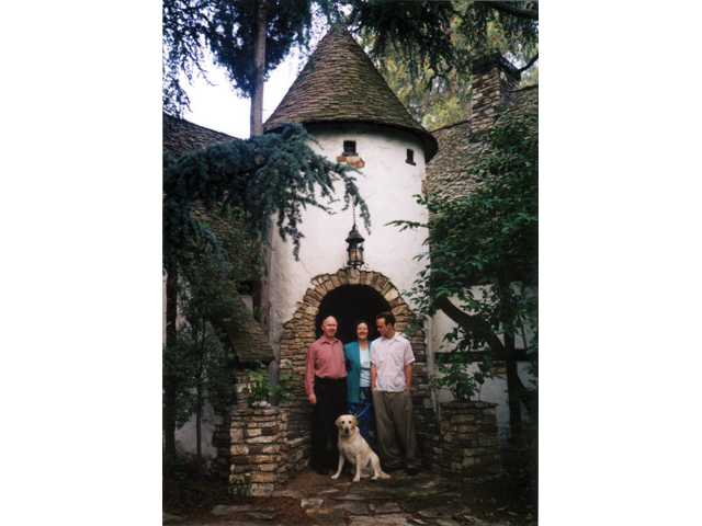 Norm Harris, left, poses for this 1998 photo with his wife, Cynthia, and their son, Howard.