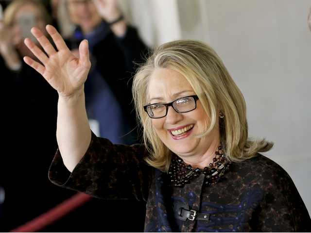 Outgoing Secretary of State Hillary Rodham Clinton waves as she leaves the State Department in Washington, Friday, for last time as America's top diplomat. (AP)