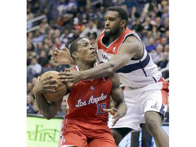 Los Angeles Clippers guard Eric Bledsoe (12) is fouled by Washington Wizards forward Chris Singleton (31) on Monday in Washington.