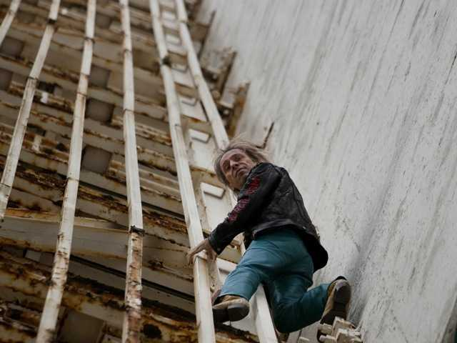 "Frenchman Alain Robert, known as ""Spiderman,"" scaled Cuba's famous Habana Libre hotel on Monday without ropes or a safety net."