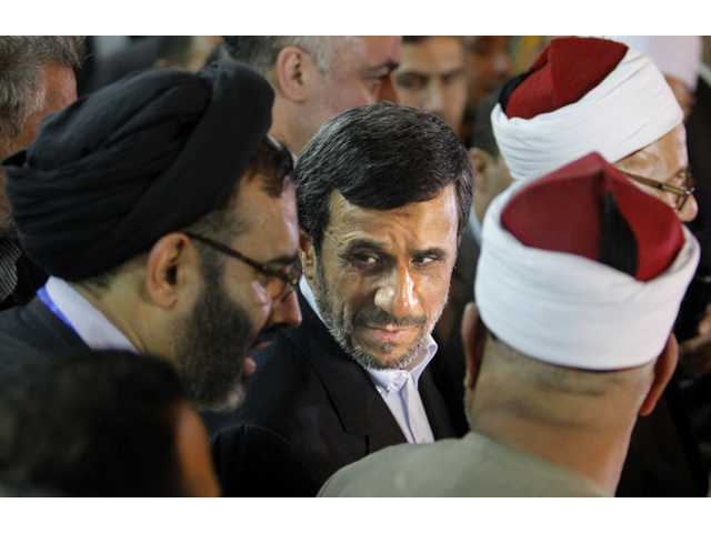 Iran's President Mahmoud Ahmadinejad, center, attends a press conference with Egyptian Sunni clerics at Al-Azhar headquarters.