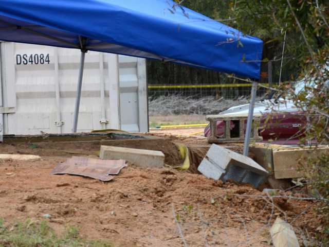 A tent covers the bunker where where a 5-year-old child was held for a week by Jimmy Lee Dykes in Midland City, Ala.
