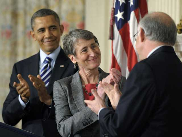 President Barack Obama and his Interior Secretary nominee REI Chief Executive Officer Sally Jewell, center.