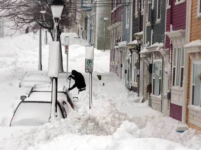 Residents try to dig out in the aftermath of a snowstorm in Canada on Jan. 11. A new blizzard of potentially historic proportions is expected to hit the Northeast with a vengeance Friday.