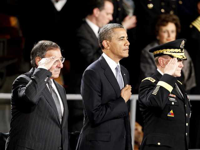 President Barack Obama attends an Armed Forces Farewell Ceremony to honor outgoing Defense Secretary Leon Panetta, left, Friday.