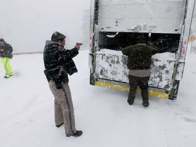 Members on the California Highway Patrol search a truck Friday for Christopher Dorner, a former Los Angeles police officer accused of carrying out a killing spree because he felt he was unfairly fired from his job.