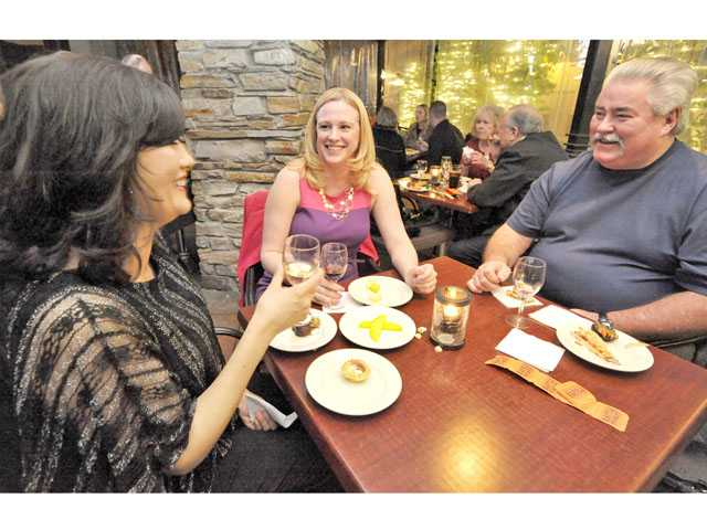 From left, Jessica Solis, Janice Cash and Jim Peterson enjoy wine, appetizers and conversation at Salt Creek Grille in Valencia.