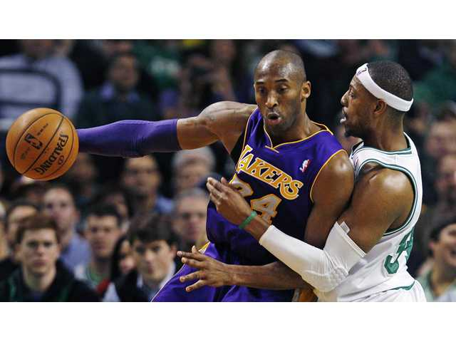 Boston Celtics forward Paul Pierce, right, pressures Los Angeles Lakers guard Kobe Bryant.