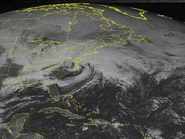 This NOAA satellite image taken Friday at 1:45 p.m. EST shows a major winter storm south of New England.