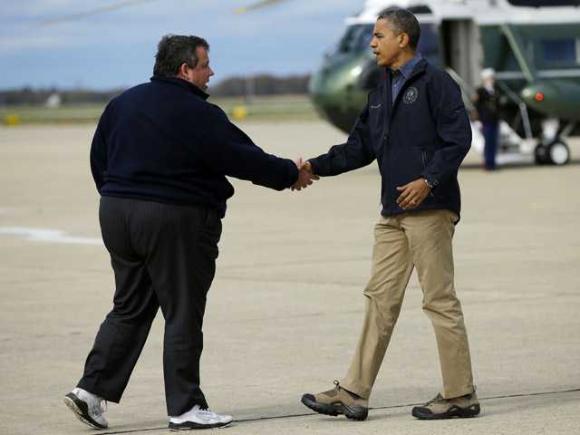 President Barack Obama is greeted by New Jersey Gov. Chris Christie upon his arrival at Atlantic City International Airport in Atlantic City.