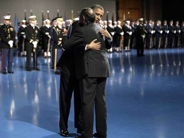 President Barack Obama hugs outgoing Defense Secretary Leon Panetta during a Farewell Tribute for Panetta.