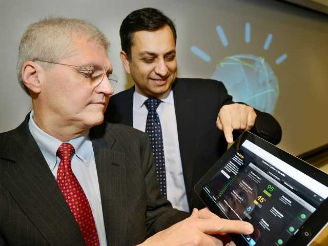 "Mark Kris, MD, Chief of Thoracic Oncology at Memorial Sloan-Kettering Cancer Center, left, and Manoj Saxena, IBM General Manager, Watson Solutions, demonstrate a tablet which can help diagnose and treat lung cancer.  announced two Watson-based applications on Friday, one to help diagnose and treat lung cancer and one to help manage health insurance decisions and claims. (by both doctors and health Insurance to access medical applications on IBM's ""Watson"" computer system, Friday, Feb. 8, 2013 in Armonk, N.Y. IBM Corp., the health insurer WellPoint Inc. and Memorial Sloan-Kettering Cancer Center announced two Watson-based applications on Friday, one to help diagnose and treat lung cancer and one to help manage health insurance decisions and claims. (AP Photo/IBM, Jon Simon)"