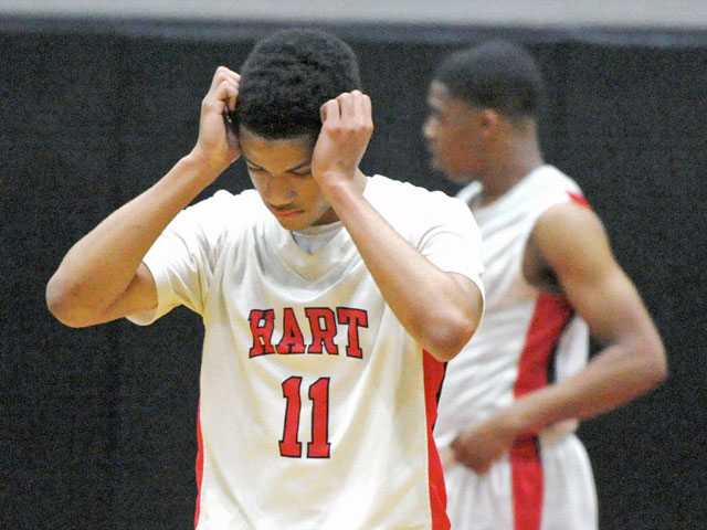 Hart guard Myles Franklin reacts to a missed point in the final seconds against Canyon on Friday night at Hart High.