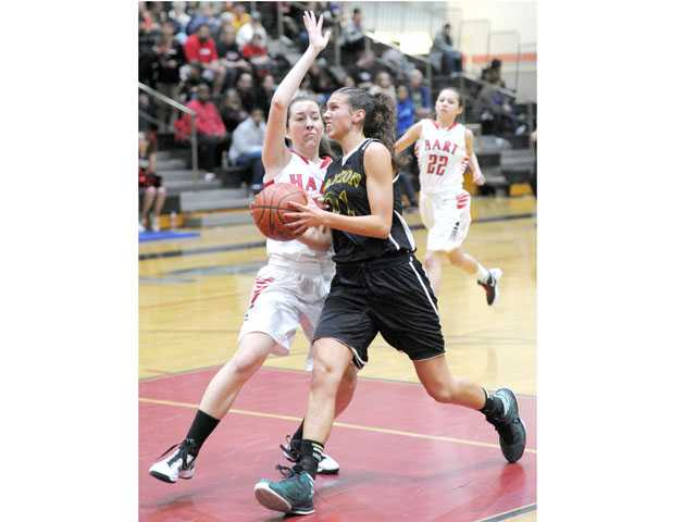 Canyon's Jaya Schultz drives past Hart's Cyndi King on Friday at Hart High.