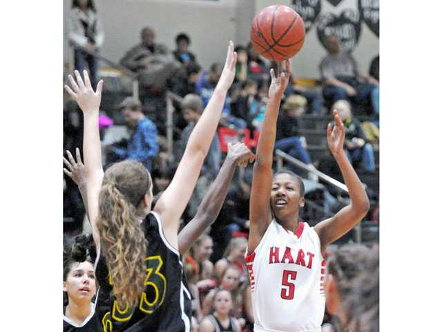 Hart's Breze Kimble shoots against Canyon's Delaney McCann on Friday at Hart High.