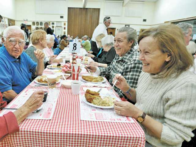 From left, Marge Galipeau, Bernie Galipeau, Ron Whalley and Anne Marie Whalley enjoy meals and conversation at St. Clare's Catholic Church's 34th annual Lenten Fish Fry in Canyon Country on Friday. (Jonathan Pobre/The Signal)