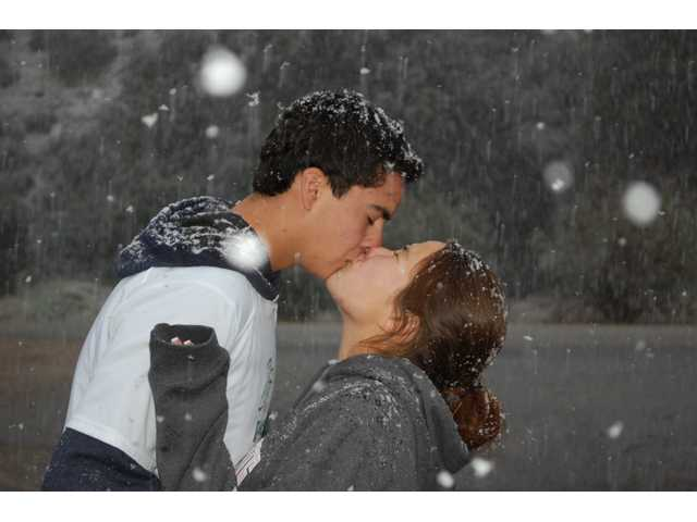 Joey Miskell and Tiana Yamaoka share their first snow kiss. Photo by Susan Yamaoka
